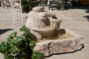 A water feature combining polished and unpolished stone.