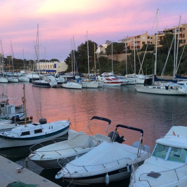 Boats in Porto Cristo at sunset.