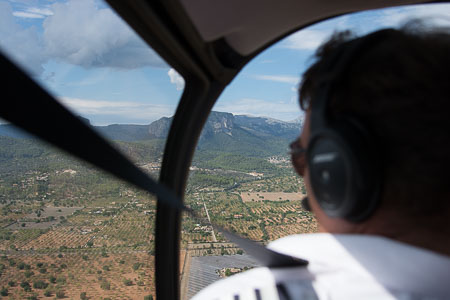 Jonny Greenall flies the R66 Turbine Helicopter over Mallorca.